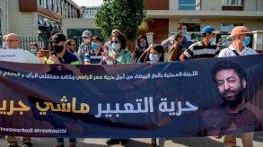 160 صحافيا مغربيا يطالبون بالإفراج عن الريسوني والراضي